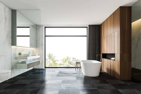 Interior of spacious bathroom with white marble and wooden walls, gray tiled floor, comfortable bathtub, double sink and toilet. 3d rendering