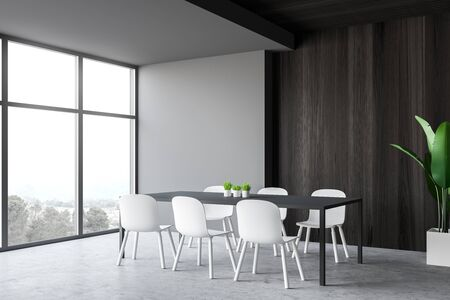 Interior of minimalistic dining room with gray and dark wooden walls, concrete floor, comfortable long grey dining table with chairs and potted plant. 3d rendering