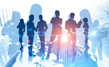 Silhouettes of diverse business people standing in modern city with double exposure of forex graph and globe. Stock market concept. Toned image. Elements of this image furnished by NASA