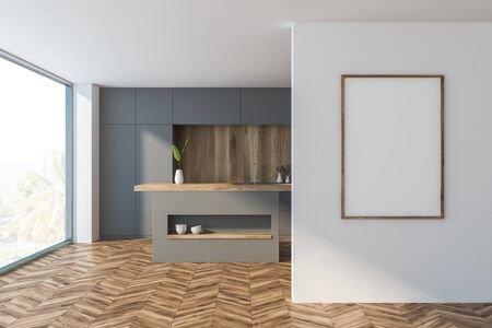 Interior of comfortable kitchen with white and wooden walls, wooden floor, panoramic window, grey countertops and vertical mock up poster frame. 3d rendering