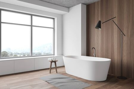 Corner of modern bathroom with white and wooden walls, wooden floor, window with mountain view, comfortable bathtub and floor lamp. 3d rendering