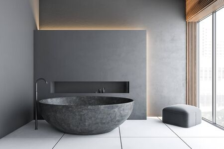 Interior of luxury bathroom with gray walls, white tiled floor, round stone bathtub and armchair in the corner. Concept of spa. 3d rendering