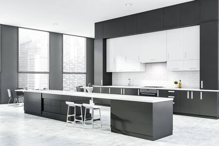 Corner of stylish kitchen with gray and white brick walls, concrete floor, dark gray countertops, bar with stools and two round dining tables. 3d rendering