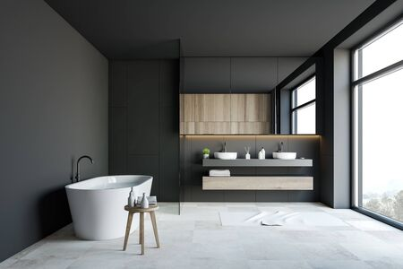 Interior of luxury bathroom with dark grey walls, white tiled floor, comfortable bathtub with water and double sink with large mirror above it. 3d rendering Banque d'images - 131330877