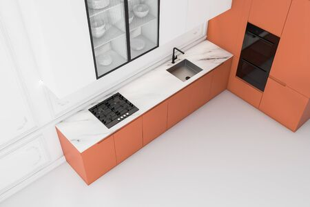 Top view of bright luxury kitchen with white walls and floor, white cupboards, orange countertops with built in sink and cooker and two modern ovens. 3d rendering