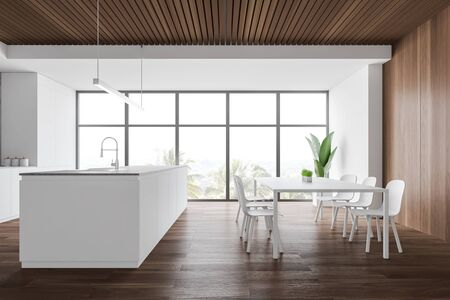 Interior of modern kitchen with white and wooden walls, wooden floor, large window with tropical view, white dining table with chairs and island with built in sink. 3d rendering
