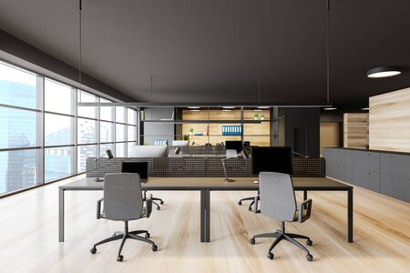 Open space office interior with dark gray walls, wooden floor, panoramic window with cityscape, rows of computer tables and bookcase with folders. 3d rendering Stock Photo