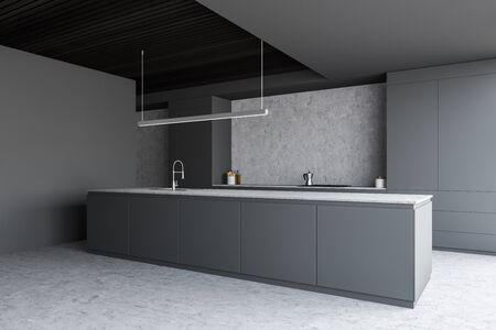 Corner of stylish kitchen with grey and concrete walls, concrete floor, gray island with built in sink and countertops with cooker. 3d rendering