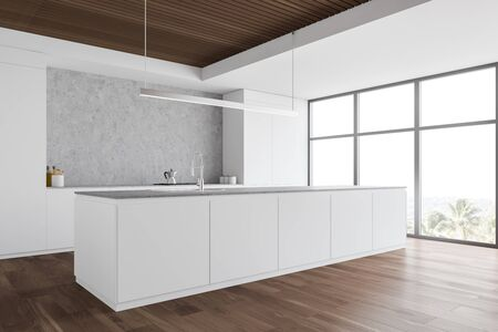 Corner of stylish kitchen with white and concrete walls, wooden floor, large window with tropical view, white island with built in sink and countertops with cooker. 3d rendering Stock Photo