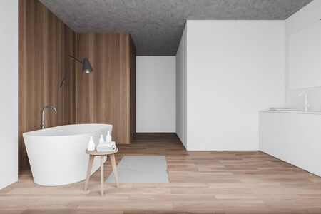 Interior of minimalistic bathroom with white and wooden walls, wooden floor, chair with towels, comfortable bathtub, white sink and floor lamp. 3d rendering