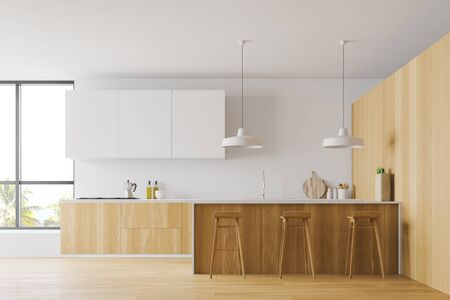Interior of spacious kitchen with white and wooden walls, wooden floor, large windows, wooden countertops, white cupboards and bar with stools. 3d rendering Stock Photo