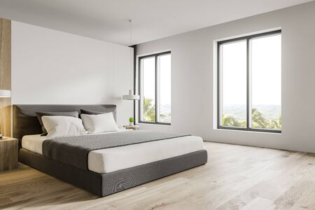 Corner of stylish master bedroom or hotel suite with white and wooden walls, wooden floor, king size bed and windows with tropical view. 3d rendering