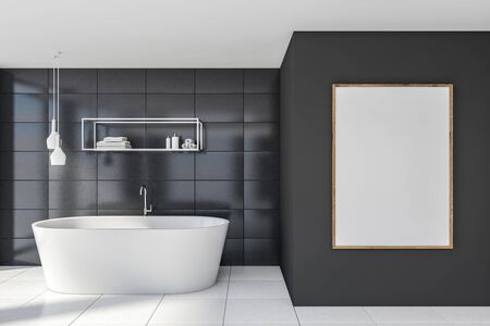 Interior of minimalistic bathroom with gray tile walls, white floor, comfortable bathtub, vertical mock up poster and shelves with beauty products. 3d rendering