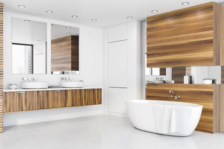 Interior of stylish bathroom with white and wooden walls, white tiled floor, comfortable bathtub and double sink on wooden countertop with vertical mirrors. 3d rendering Фото со стока