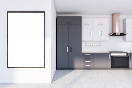 Interior of stylish kitchen with white walls, concrete floor, grey countertops with built in stove, white cupboards and vertical mock up poster frame. 3d rendering
