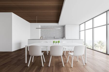 Interior of modern kitchen with white and wooden walls, wooden floor, large window with tropical view, white dining table with chairs, island with built in sink and white countertops. 3d rendering