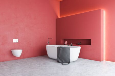 Corner of stylish bathroom with red walls, concrete floor, comfortable white bathtub and toilet. Concept of luxury house. 3d rendering Фото со стока
