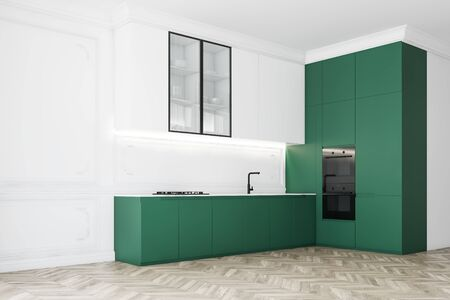 Corner of bright luxury kitchen with white walls, wooden floor, white cupboards, green countertops with built in sink and cooker and two modern ovens. 3d rendering