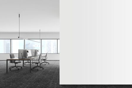 Interior of panoramic office with white walls, carpeted floor, columns and rows of computer desks. Mock up wall to the right. Advertising concept. 3d rendering