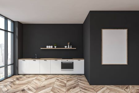 Interior of stylish kitchen with dark gray walls, wooden floor, white countertops with built in sink and oven and wooden shelf with dishes. Vertical mock up poster frame. 3d rendering 写真素材