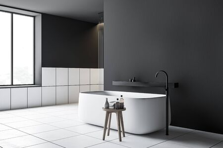 Corner of modern bathroom with dark gray walls, white tiled floor, comfortable bathtub with shelf above it and chair with towels and beauty products. 3d rendering