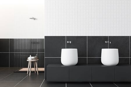 Interior of modern bathroom with white and gray tile walls, black tiled floor, comfortable shower and double sink on gray countertop. 3d rendering