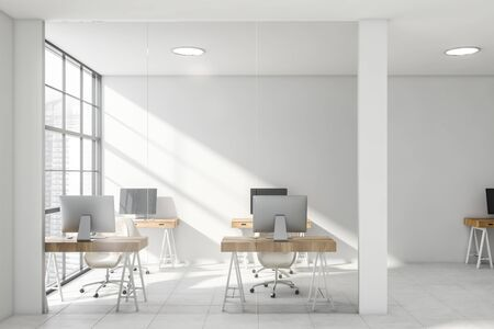 Interior of comfortable office or college computer lab with white walls, tiled floor and rows of compact wooden computer tables. 3d rendering