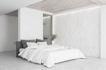 Corner of modern bedroom with white and crude wall, concrete floor, king size bed and bathroom with shower in background. 3d rendering