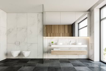 Interior of stylish hotel bathroom with white marble walls, gray tiled floor, double sink on wooden countertops with large mirror and two toilets. 3d rendering