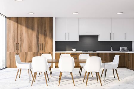 Long wooden dining table with white chairs standing in modern kitchen interior with white and gray brick walls, wooden countertops and white cupboards. 3d rendering