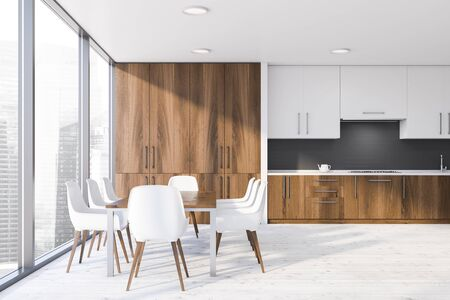 Interior of stylish kitchen with white and gray brick walls, wooden floor, dark wooden countertops with sink and stove and white cupboards. Wooden dining table with white chairs. 3d rendering