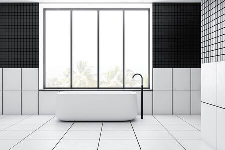 Interior of stylish minimalistic bathroom black tiled walls, white tiled floor and comfortable white bathtub standing under window with tropical scenery. 3d rendering