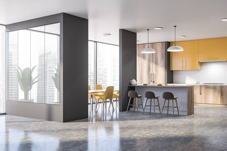 Interior of spacious kitchen with gray walls, concrete floor, yellow cupboards, bar with stools, dining table and wooden countertops. 3d rendering Banco de Imagens