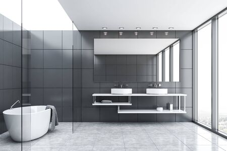 Interior of comfortable bathroom with grey tile and glass walls, gray tiled floor, comfortable bathtub with towel hanging on it and double sink with large mirror. 3d rendering