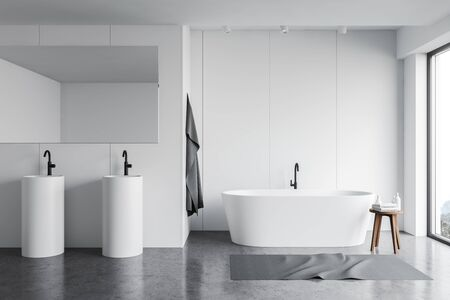 Interior of stylish bathroom with white panel walls, concrete floor, comfortable bathtub with carpet near it and two round sinks with large mirror. 3d rendering