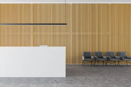 Simple white office reception desk with two computers and stylish ceiling lamp in modern office hall with wooden walls and concrete floor. Lounge area with row of armchairs. 3d rendering