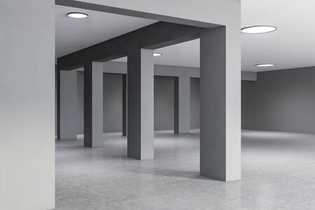 Columns in empty office hall interior with gray walls, concrete floor and stylish round lamps. Loft style. Concept of interior design. 3d rendering