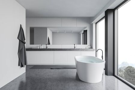 Interior of modern bathroom with white panel walls, concrete floor, panoramic windows, comfortable bathtub and double sink with horizontal mirror. 3d rendering