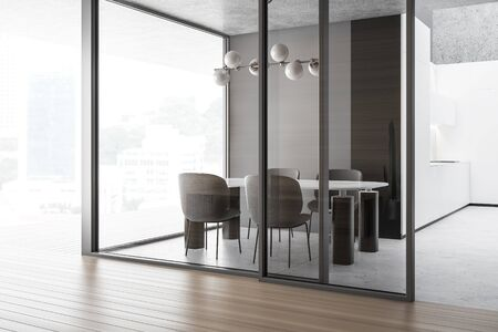 Interior of spacious kitchen with white and dark wooden walls, panoramic window, concrete floor, white countertops and massive dining table with gray chairs. 3d rendering