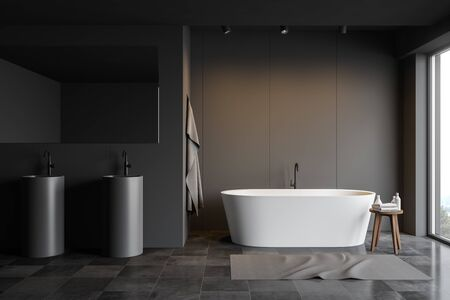 Interior of stylish bathroom with gray panel walls, tiled floor, comfortable bathtub with carpet near it and two round sinks with large mirror. 3d rendering