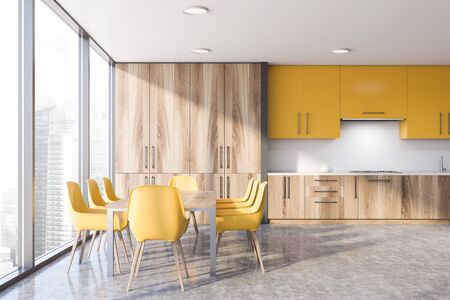 Interior of stylish kitchen with gray and white walls, concrete floor, wooden countertops with sink and stove and yellow cupboards. Wooden dining table with yellow chairs. 3d rendering