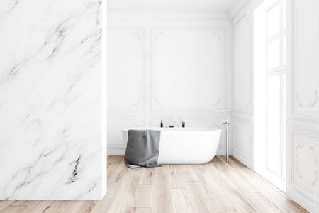 Interior of classic style bathroom with white marble walls, wooden floor, comfortable bathtub with gray towel on it and big window. 3d rendering