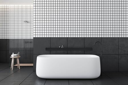 Interior of modern bathroom with white and gray tiled walls, dark grey tiled floor, comfortable bathtub with shelf above it and shower stall with glass wall. 3d rendering