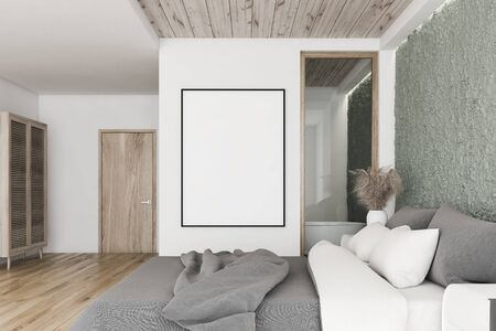 Interior of master bedroom with white and crude concrete walls, wooden floor, king size bed, vertical mock up poster frame and bathroom with tub in background. 3d rendering