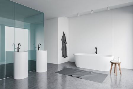 Corner of stylish bathroom with white panel and blue glass walls, concrete floor, comfortable bathtub and two oblong sinks. 3d rendering Banco de Imagens