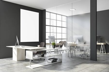 Interior of stylish CEO office with gray and glass walls, concrete floor, comfortable desk and open space area with compact computer tables in background. Vertical mock up poster. 3d rendering Imagens