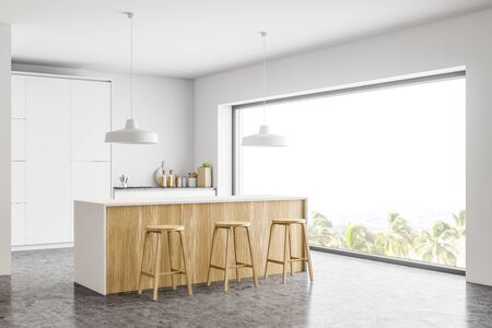 Corner of stylish kitchen with white walls, concrete floor, white countertops, wooden bar with stools and panoramic window. 3d rendering