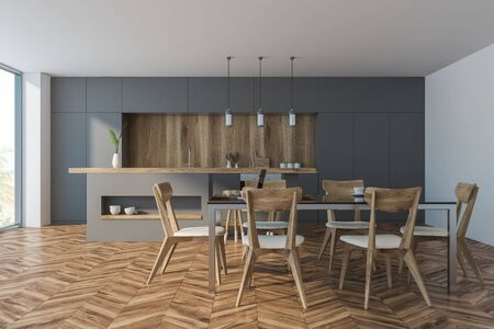 Interior of comfortable kitchen with white and wooden walls, wooden floor, panoramic window, grey countertops and bar with stools. Cozy dining table with chairs. 3d rendering