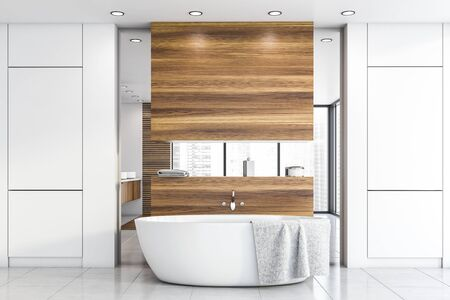 Interior of stylish bathroom with white and wooden walls, tiled floor, comfortable white bathtub with towel on it and mirror. 3d rendering