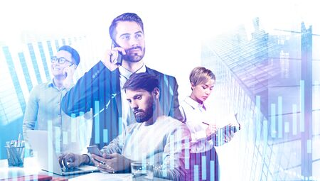 Diverse young business people working with gadgets in modern city with double exposure of digital charts. Concept of stock market and teamwork. Toned image Imagens